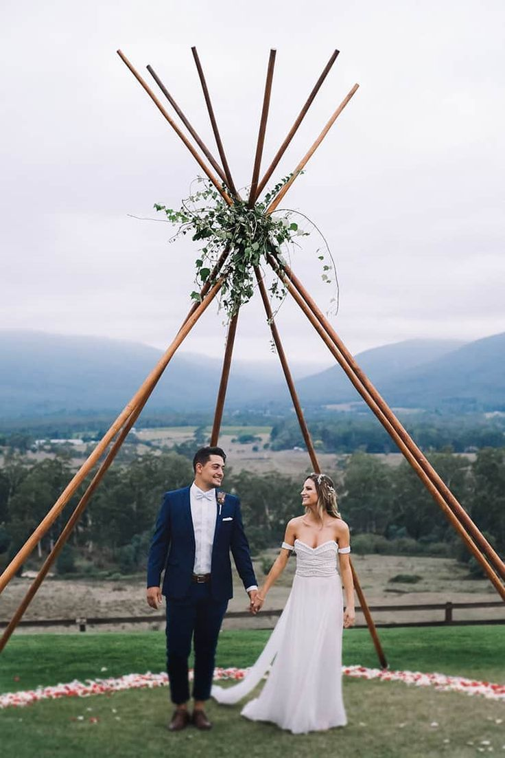 Boho outdoor wedding ceremony with naked tipi and greenery at The Riverstone Estate in the Yarra Valley | Enchanted Wedding Photography