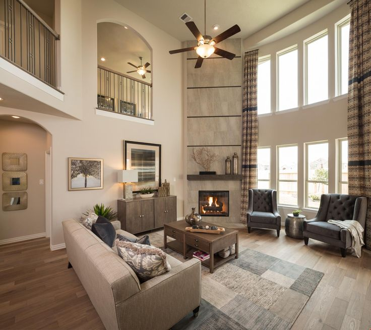 A soaring, two-story great room makes a dramatic design statement. A new home in the Camellia - Marquis community built by Legend Homes. Richmond, TX.