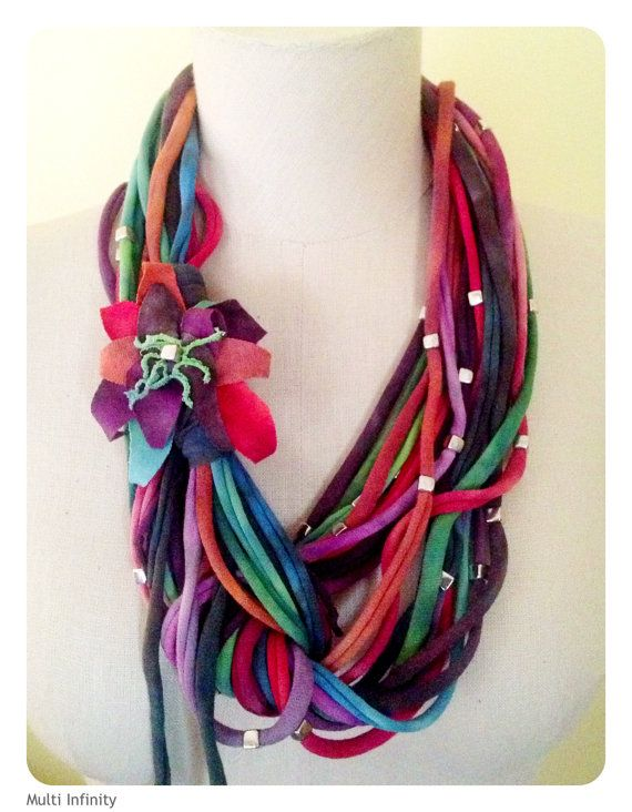 100% cotton is hand dyed and cut, beaded and tied with a hand cut jersey flower to create an infinity style jersey loop scarf that can be worn