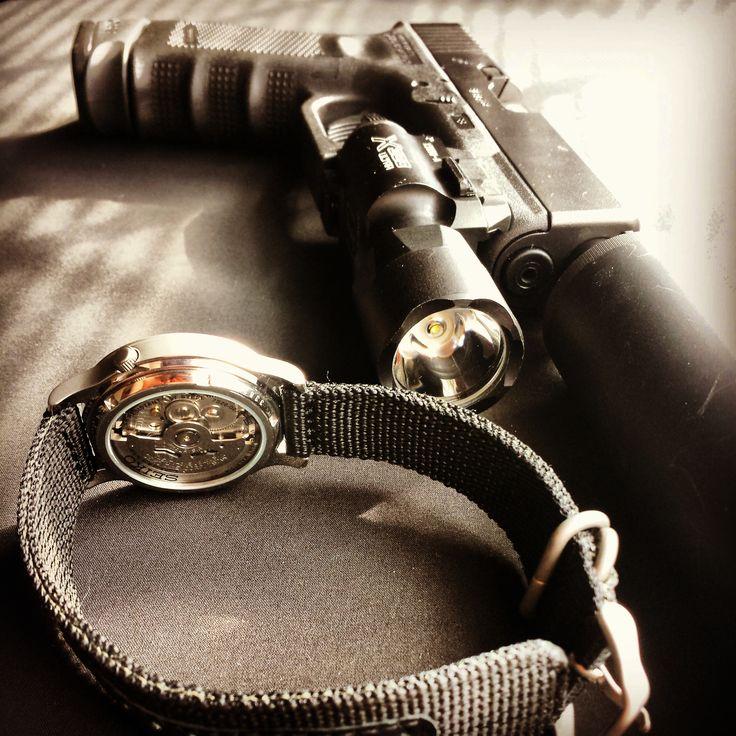 My Seiko SNK809 automatic watch; my Glock 19 w/ Surefire x300 Ultra and SWR Octane 9 suppressor