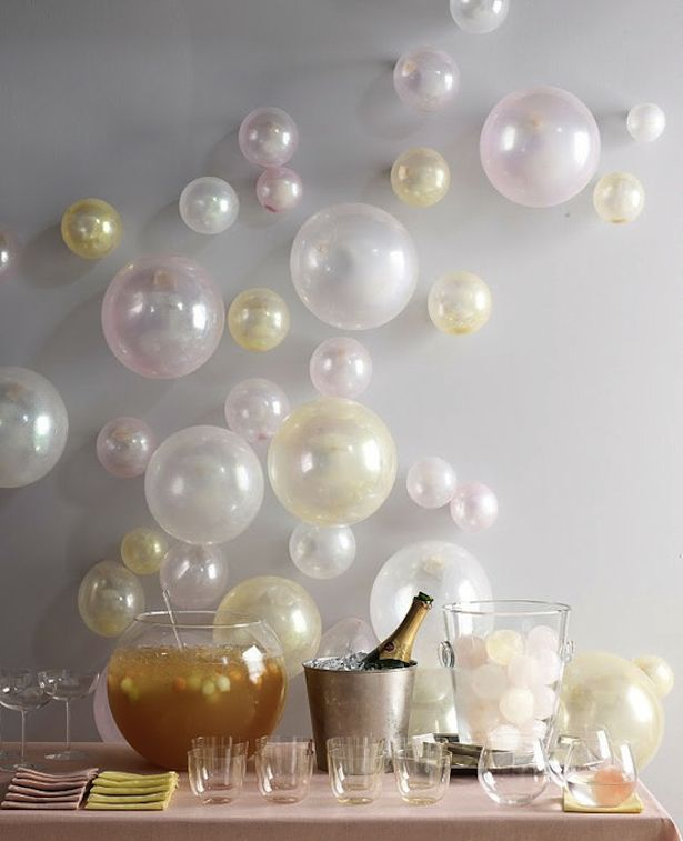 """Champagne table with individual splits with chalkboard that reads """"pop your bottle, when the clock strikes midnight."""""""