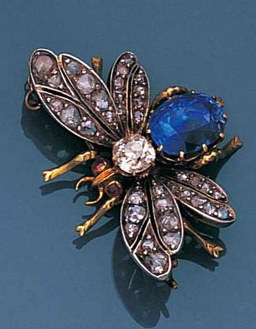 A late 19th century sapphire and diamond bee brooch, circa 1890 The abdomen set with an oval mixed-cut sapphire, the body with an old brilliant-cut diamond, to pierced rose-cut diamond wings, later pin fitting, width 3.6cm.
