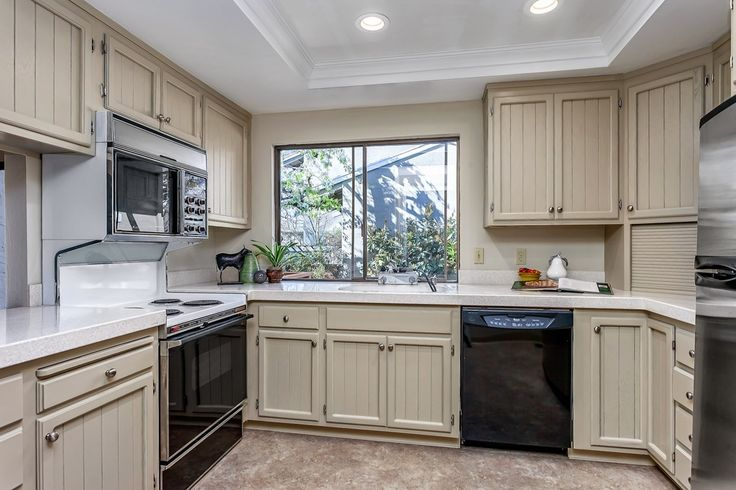 Cottage Kitchen with Simple granite counters, Inset cabinets, Flat panel cabinets, Cambria Snowdon White, European Cabinets
