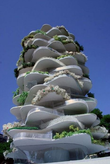 Apartment building with tiers of gardens. Reminds me of one of my 3rd yr projects.