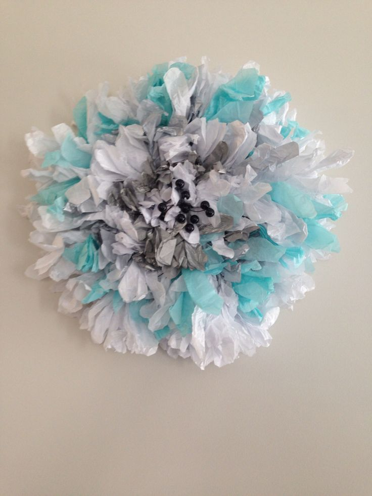 Paper flower with middle beads.