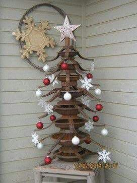 Outdoor Christmas tree made from Christmas tree stands. No directions that should be easy enough to do