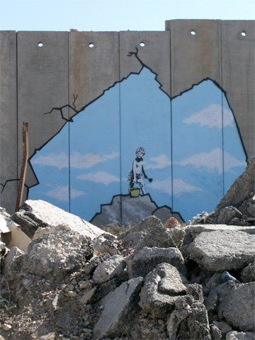 "The West Banksy: Bansky at the West Bank ""security fence."""