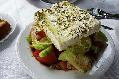 """Greek Salad (called Horiatiki Salata in Greek), is a traditional salad made of the most simple, fresh ingredients. Unfortunately, in many countries throughout the world a """"Greek"""" salad looks nothing..."""