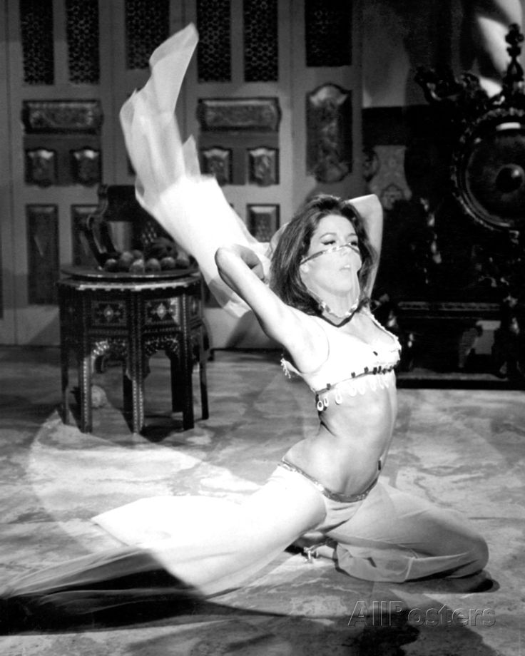 Diana Rigg as Mrs Emma Peel of 'The Avengers' performing 'the dance of the seven veils' in the 26 March 1966 episode 'Honey for the Prince'
