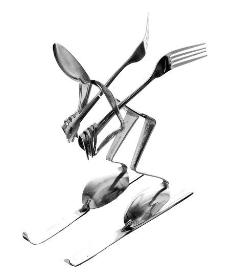 Freestyle décor. Fresh and funky, this clever figurine was crafted from stainless steel utensils for a cool eclectic vibe.