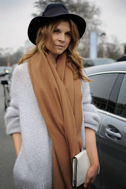 Clemence Poesy is the epitome of French chic. A hat and scarf for outdoor meditation in the cold.