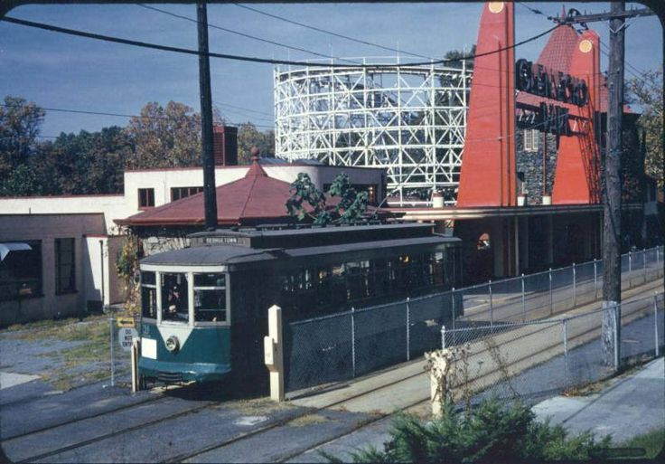 "Operating for new owners with a new number (766) and a new livery, Capital Traction 27 stops in front of Glen Echo Park on a  charter trip.  Recalling the era of charter trips in the 1950s and the final farewell run in 1962, many streetcar historians still refer to the car as ""766."". (NCTM)"