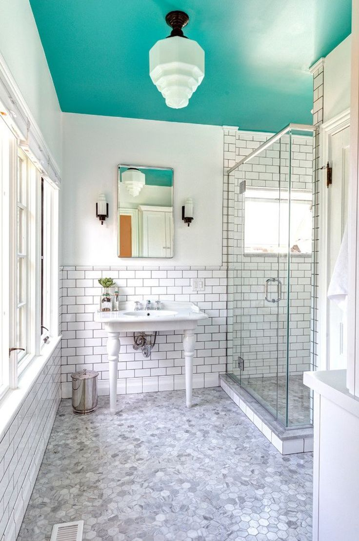 Painted Ceilings in the Bathroom - I like the idea of painting a bright blue on the ceiling in my small bathroom for a pop of color and a quick update. I'm also considering painting the molding around the window black to reinforce the black and white current scheme.