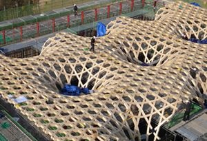 """The building's wooden hexagon grid shell, an ecological and naturally ventilated concept of a hexagon pattern, is based an a Korean traditional summertime pillow (called"""" bamboo wife""""). The most innovative feature is the hexagon grid shell roof. The fire-resistant roof and columns are exposed in the interior spaces."""
