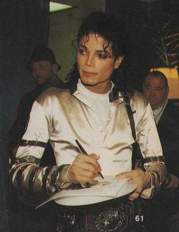 Signing another autograph---I wish I had gotten to see a concert of his--much less meet him. :)