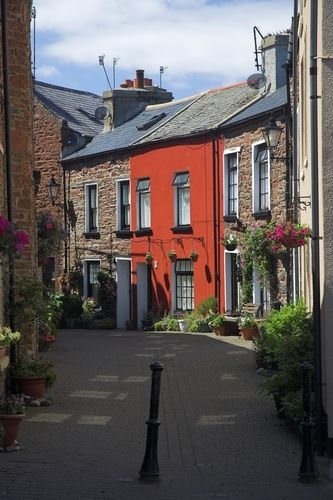 Charles Street, on The Isle of Man, England. The houses are mostly Peel Sandstone and the traditional street lights retain it's quaint quality.