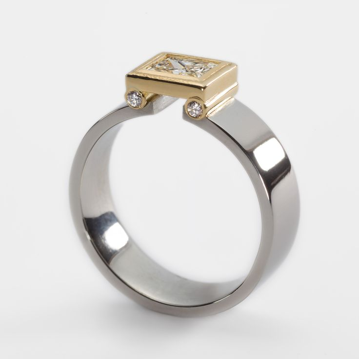 Platinum engagement ring with 0.53ct princess cut diamond in 18ct yellow gold setting. Engagement rings Cork city.