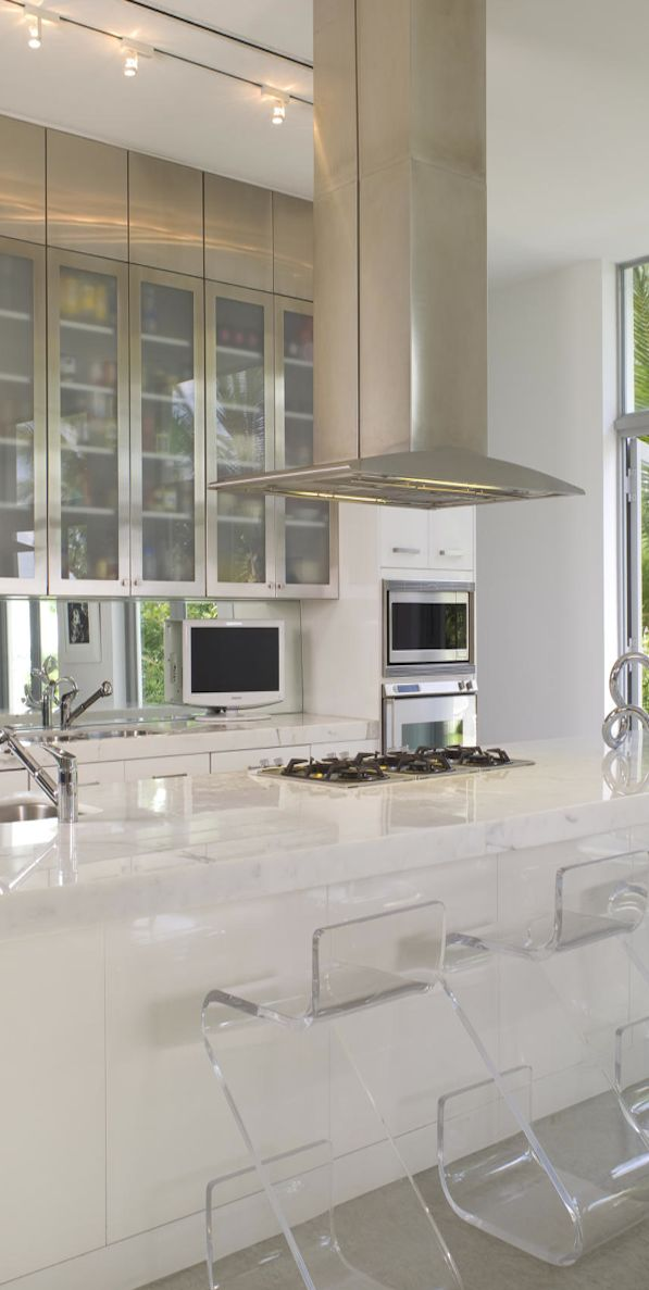 Modern Kitchen by Brown Davis Interiors...Villa Nirvana, Miami Beach...I love all the white they use in Miami Beach homes...often with a splash of color.