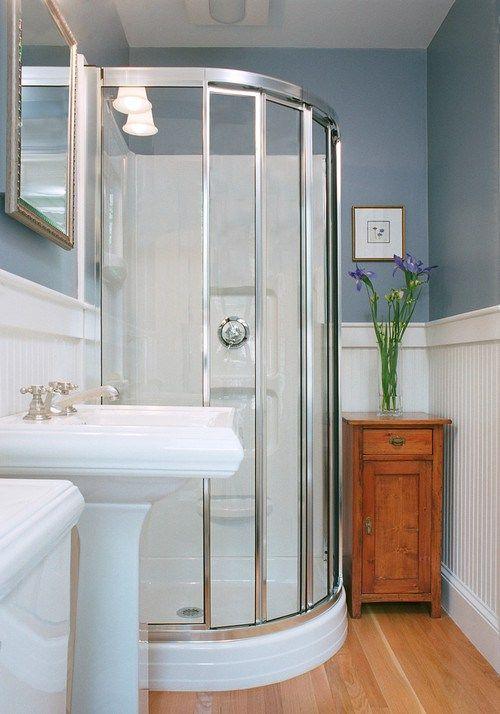 decorating ideas for a fibreglass corner shower with wainscoting