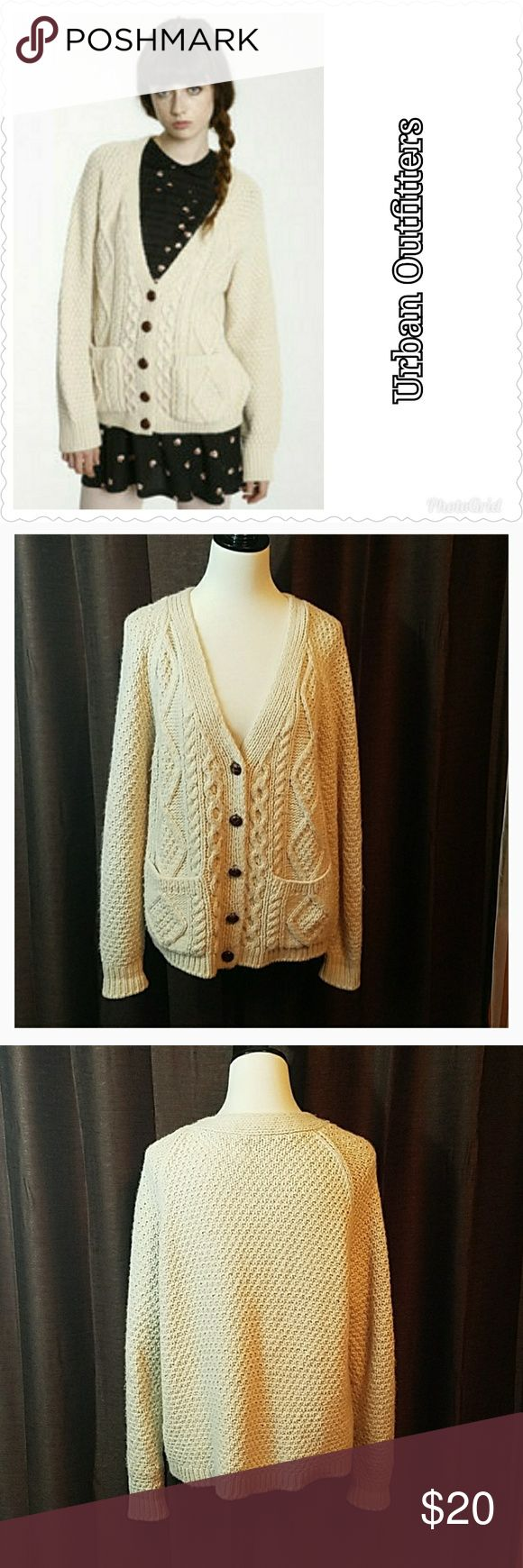 Oversized Grandpa cardigan sweater This cream-colored cardigan sweater is super cute. The brand is Neal Sperling which is from Urban Outfitters. With a cable knit pattern on the front and large brown buttons. Two pockets on the front. Excellent used condition. Please feel free to ask questions about fit and style before purchasing. Urban Outfitters Sweaters Cardigans