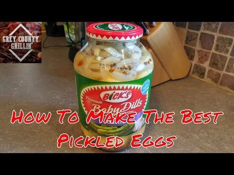 1.) Place eggs in a large pot and cover with cold water. Bring water to a boil and immediately remove from heat. Cover and let eggs stand in hot water for 10 to 12 minutes.  Place the peeled eggs into a 2 litre jar.  2.) In a saucepan, combine the rest and bring to a rolling boil; pour over the eggs in the jar. Place a couple of slices of onion on top and seal the jars. Cool to room temperature, then refrigerate for 3 days before serving.