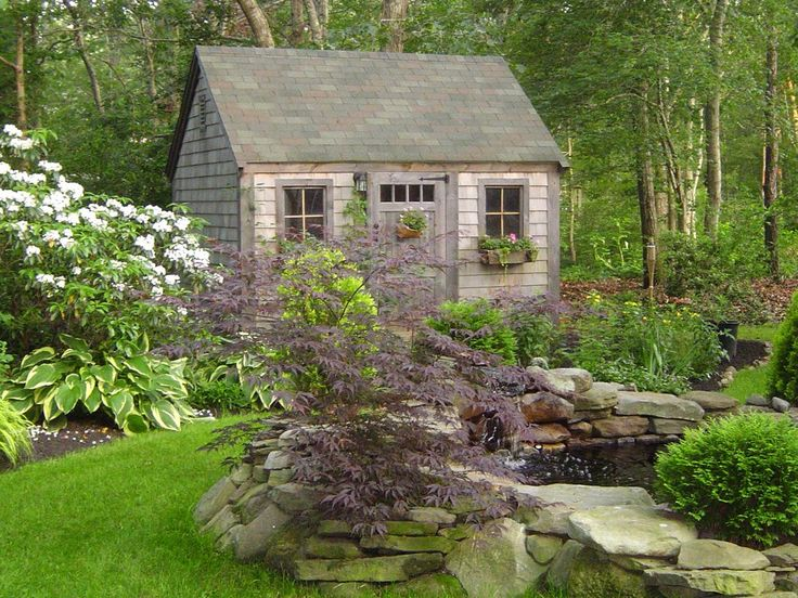 sweet garden shed tucked into the beautiful landscaping