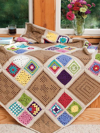 """This beautiful afghan is made using granny and filet square design patterns. A total of 61 squares made using a DK-weight yarn complete the design. Finished afghan size is 48"""" square."""