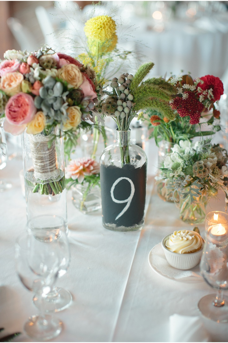 chalkboard paint on glass bottle centerpieces    RachelDanny_Tiburon_Lyford-House-wedding-photographer_056