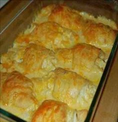 Recipe for Chicken Crescent Roll Casserole - A tasty and hearty casserole to wrap up the winter. Chicken hidden underneath pillows of crescent rolls. Feed your crowd without breaking the bank.