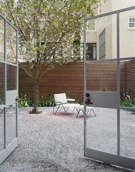 gravel courtyard, nice fencing.