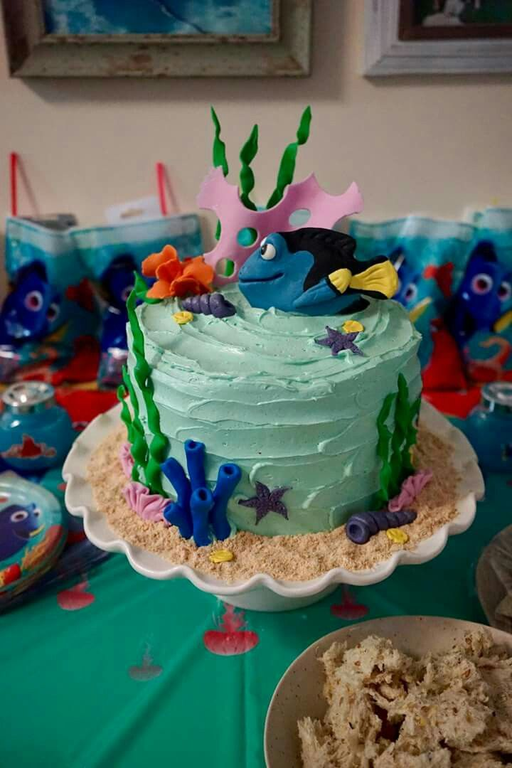 Finding Dory cake.  Gum paste dory and rolled icing coral.  Arrowroot biscuit sand.  Used toilet paper rolls cut in half to creat large pink corals dimension (place under baking paper).  Other coral created from pinterest  pins.
