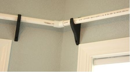 She keeps PVC pipes on her wall above the windows and the reason why is genius!