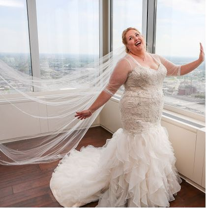 Beaded plus size wedding dresses with sheer sleeves can be custom created for any bride of any size.  We can make any change to a design like this that a bride may want or need to help the design be her own.  Our firm is located in the USA and offers brides affordable #plussizeweddingdresses that are custom to each specific bride. You can also obtain a similar replica of a couture bridal gown for much less than the origial.  Contact us on our website for pricing & info