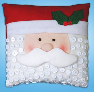 """Santa Button(5190)  Christmas felt applique kit designed to make a Christmas cushion - produced by 'Design Works.'  Contents: Pre-sewn pillow, Felt, Fabric pieces, buttons, cottons, needle and full instructions.  Size: 15"""" x 15""""  RRP £19.99"""