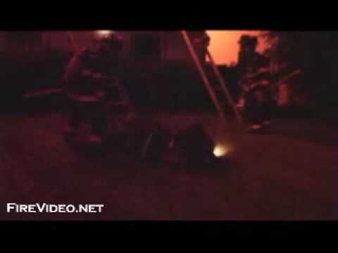 """Firefighter's Close Call-Bailout EXCELLENT VIDEO. Firefighters try to Search for a reported Trapped Occupant and a Room """"Flashes Over"""" sending the Firefighter out the Window Head 1st. No one was Found in the Building!"""