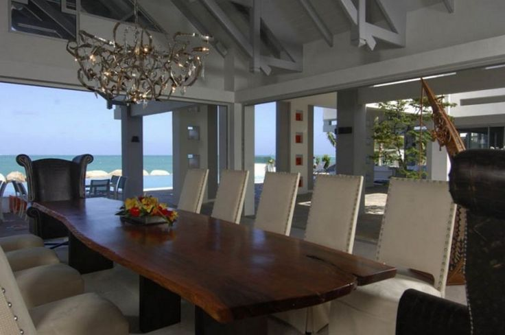 Decoration: Awesome Le Reve St Martin Beach House Dining Room Decor Featuring Natural Wooden Dining Table With Stylish White Leather Chairs Beneath Luxurious Modular Chandeliers: Cozy Beach House For Vacation Places Idea