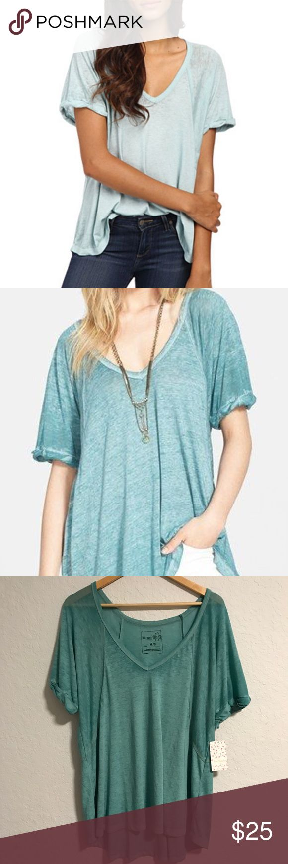 Free People Free Fallin Tee (discontinued color) New twist on an old FP fave, this tee features the same slouchy, oversized fit but it's in a so-soft burnout jersey. Ribbed V-Neck with rolled short sleeves. Subtle Hi-Lo hem. Color is called Dusty Jade. Size Medium.  We The Free  FP EXCLUSIVE :Only sold thru Free People. One of nine exclusive, in-house labels. Perfectly distressed, all-American styles.  50% Polyester 38% Cotton 12% Rayon Machine Wash Cold Free People Tops Tees - Short Sleeve