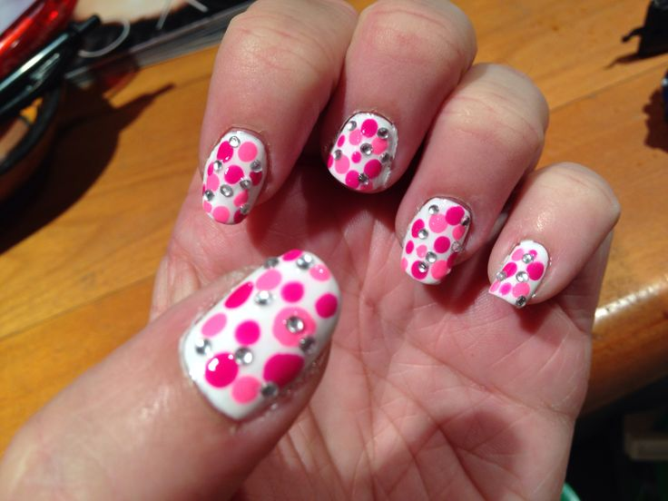 Pink dots with rhinestones on a white base.  Love!!!