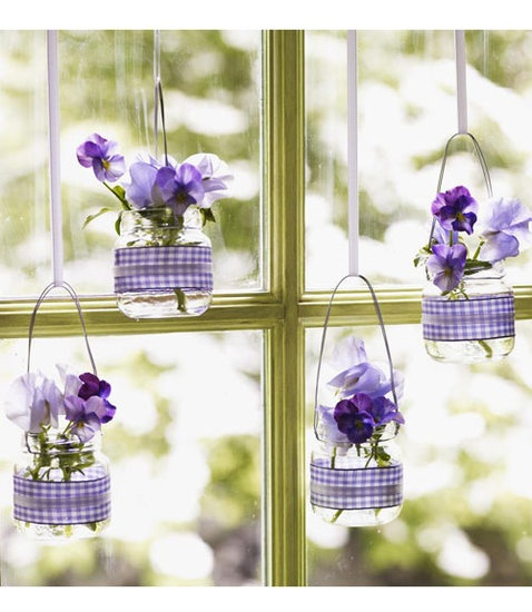 Hanging Baby-Food Jar Vases: Baby-food jars are the perfect size to display small flowers, like pansies, and this tutorial shows how easy it is to convert the jars into minivases. Wondering what else to do with all of those leftover baby-food jars? Weve got 20 great ideas! Source: Good Housekeeping