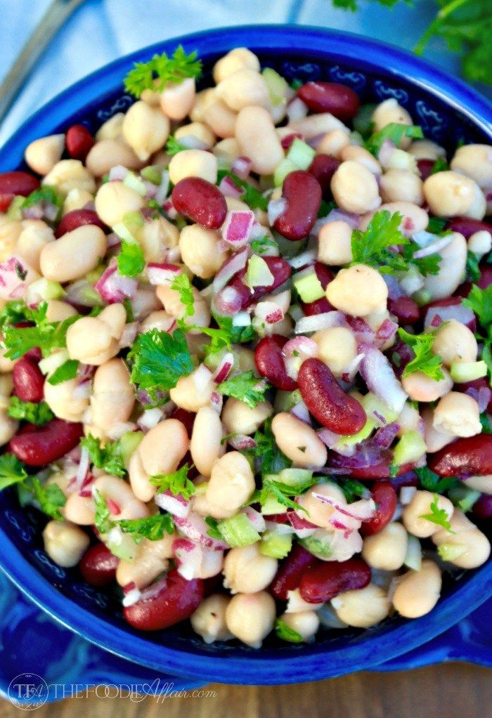 Three bean salad with a light dressing makes a delicious side dish or light lunch when served with a bed of lettuce. The Foodie Affair