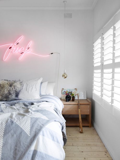 Perfect bedroom neon sign hah! || Tom Adair's home For Est Magazine, Styling Stephanie Stamatis