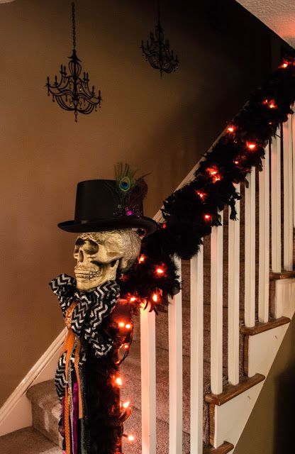 Halloween stair garland  Feathers, Raven, Poe, Decor, Lights, Chandelier http://www.entertaininggrace.com/2015/10/part-2-2015-halloween-house-preview.html
