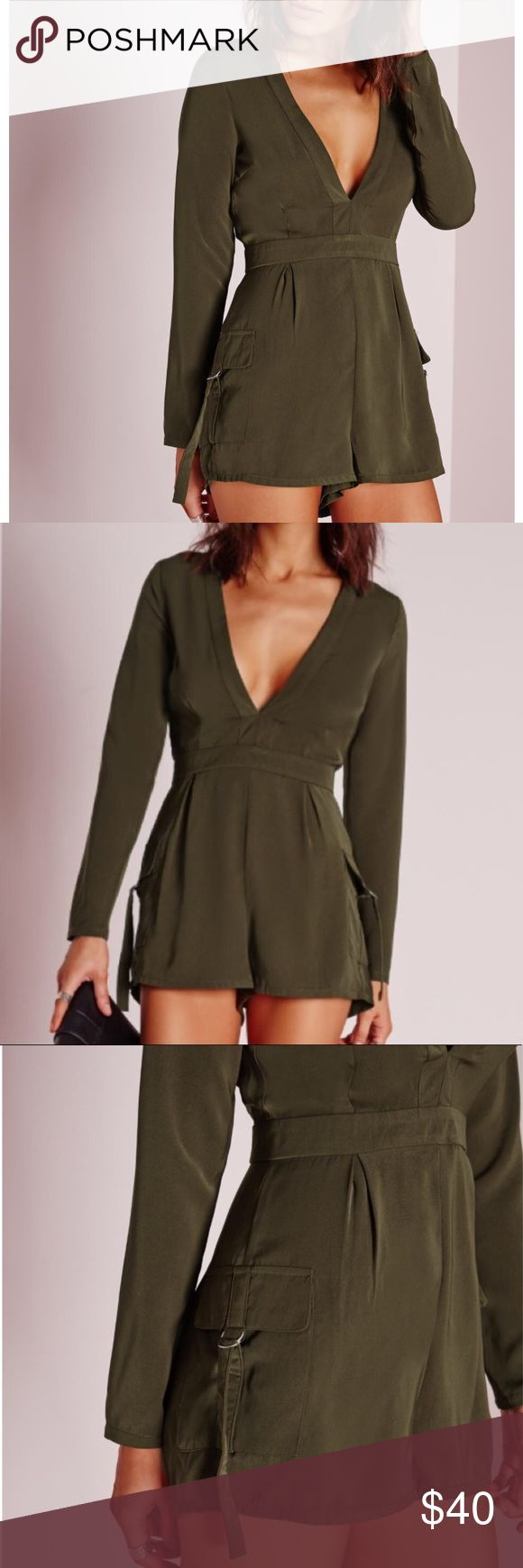 """NWT Missguided Olive Khaki Plunge Romper w/ Pocket In a seasonal olive khaki colored romper with a plunge n-neck neckline, you'll be turnin' those heads. Long Sleeve with back partial zip closire. For a throw-on-go style, team with black caged heels and a patent clutch for all-round glam. UK size 12 is equivalent to a US size 8. 2 side patch pockets with foldover buckle closure.  Measurements are approximate.  Laying flat:  Armpit to armpit: 19"""" Length: 31"""" Fabric: Polyester Missguided Pants…"""