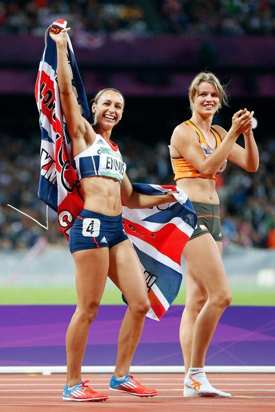 Jessica Ennis of Great Britain (L) celebrates winning gold in the Women's Heptathlon with Dafne Schippers of Netherlands on Day 8 of the London 2012 Olympic Games at Olympic Stadium on August 4, 2012 in London, England.