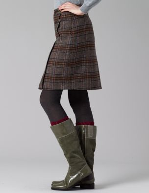 Tweed skirt and Wellies.                                                                                                                                                                                 More