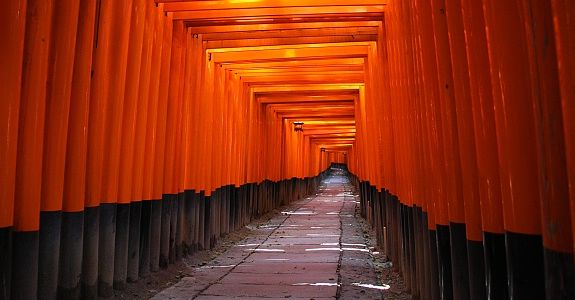 Fushimi Inari is an important Shinto shrine in southern Kyoto. A walking path leads through a tunnel of torii gates