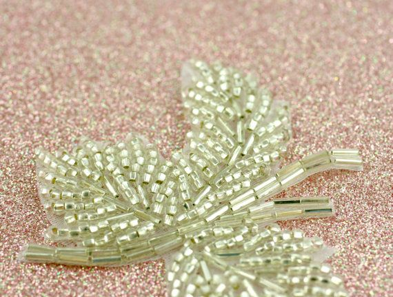 Pretty triple-leaf applique of sparkling silver beadwork.  Lovely for bridal/wedding projects, DIY, apparel, dance and skating costumes, etc..