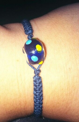 Bracelet with macrame cord and glass bead..