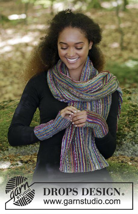 Completo formato da: sciarpa lavorata ai ferri e scaldapolsi a maglia legaccio e strisce, lavorati da lato a lato. Tutte le parti vengono lavorate in DROPS Fabel. Modello gratuito di DROPS Design.
