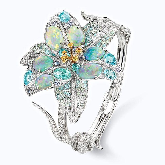 """Opaline """"Etoiles boréales"""" bracelet in black opals, Paraiba tourmalines, yellow and violet sapphires. #Chaumet #LaNaturedeChaumet #Lily"""